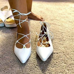 Pure white hydrogen shoes lace up
